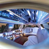 Limo with mirrored tile ceiling with Denver in the background