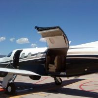 private jet with cargo door open