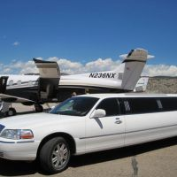 Limo parked next to private plane loading luggage