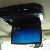 Drop down digital screen for viewing entertainment interior of the limo