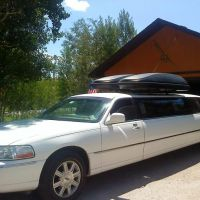 Large stretch white Stagecoach Limo